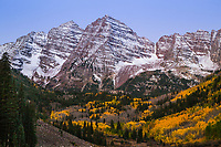 Maroon Bells of the Elk Mountains at sunrise autumn season.  Colorado.  USA.