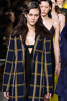 Greta Varlese walks the runway wearing Jason Wu Fall 2016, Hair by Paul Hanlon for Morocconoil, Makeup by Yadim for Maybelline, shot by Thomas Concordia during New York Fashion Week on February 12, 2016