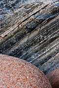 Some of the rocks in Grota Beach have strange colors and textures.