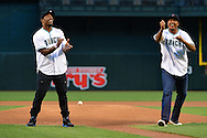 PHOENIX, AZ - APRIL 26:  Arizona Cardinals running back David Johnson (L) and wide receiver Michael Floyd react after throwing out the ceremonial first pitch prior to the MLB game between the St. Louis Cardinals and Arizona Diamondbacks at Chase Field on April 26, 2016 in Phoenix, Arizona.  (Photo by Jennifer Stewart/Getty Images)