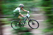 SHOT 8/19/11 10:48:22 AM - Jennifer Gersbach of Durango, Co. and the Honey Stinger/Trek team races to a first place finish in the Duo Coed category on the final day of racing in The Breck Epic in Breckenridge, Co. The event is a 6-day ultra-endurance mountain bike stage race held in the sprawling backcountry surrounding the town of Breckenridge, Co. The course is 240 miles and features a combined 38,000 feet of climbing, 90% of which is above 10,000 feet. More than 200 riders from 15 different countries participated in the race. (Photo by Marc Piscotty / © 2011)