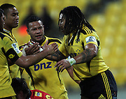 Ma'a Nonu (right) is congratulated by teammates for his try. Super 15 rugby match - Hurricanes v Lions at Westpac Stadium, Wellington, New Zealand on Saturday, 4 June 2011. Photo: Dave Lintott / photosport.co.nz