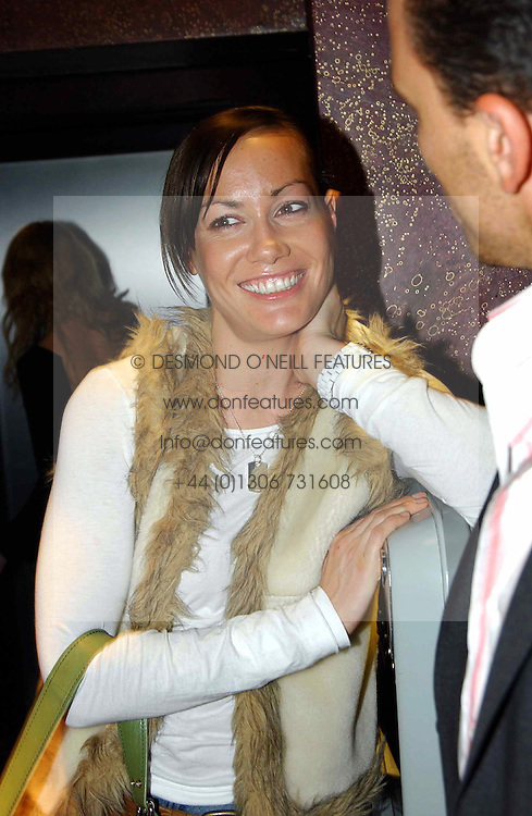 MISS TARA PALMER-TOMKINSON at a party to celebrate a new collection of sexy underware by Janet Reger called 'Naughty Janet' held at 5 Cavendish Square, London on 19th October 2004.<br />