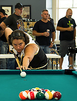 Kim Orr shoots the break during scotch doubles play in the Laconia Harley Davidson Pool Tournament to benefit the Children's Auction on Sunday afternoon.   (Karen Bobotas/for the Laconia Daily Sun)