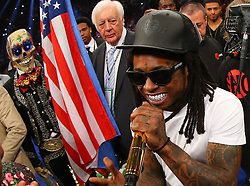 LAS VEGAS, NV - MAY 3: American rapper Lil' Wayne (right) in the ring before the start of the fight between Floyd Mayweather Jr. and Marcos Maidana at the MGM Grand Garden Arena on May 3, 2014 in Las Vegas, Nevada. (Photo by Ed Mulholland/Golden Boy/Golden Boy via Getty Images) *** Local Caption ***Justin Bieber