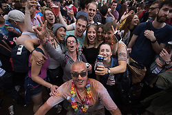 Portland Place, London, June 25th 2016. Thousands of LGBT people and their supporters gather for Pride in London, a colourful celebration of the hard-won rights of lesbian, gay, bisexual and transgender  people. PICTURED: Friends pose for a picture in Soho.