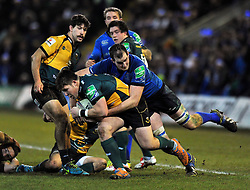 Ethan Waller (Northampton) is tackled by Devin Toner (Leinster) - Photo mandatory by-line: Patrick Khachfe/JMP - Tel: Mobile: 07966 386802 07/12/2013 - SPORT - RUGBY UNION -  Franklin's Gardens, Northampton - Northampton Saints v Leinster - Heineken Cup.