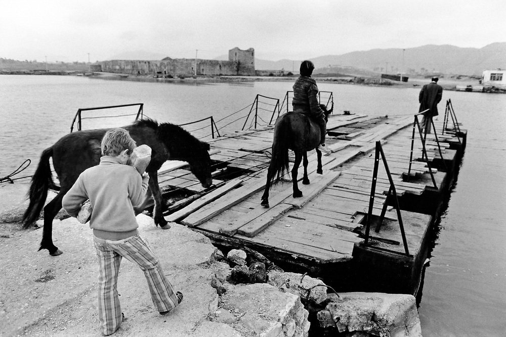 ALBANIA - Albanien - 1992 - Second democratic elections.Transition from communism to democracy; ferry near BUTRINT - boy carrying bread at home - horses ...  03/1992; near Sarander © Christian Jungeblodt