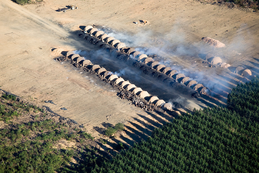 Smoke rises from charcoal ovens near eucaliptus plantations on land cleared from the Amazon rainforest on a fazenda owned by Sidepar (Siderurgica Do Para), in Ulianopolis Municipality, Para State, Brazil, August 12, 2008..Daniel Beltra/Greenpeace