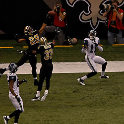 November 21, 2010; New Orleans, LA, USA;  New Orleans Saints safety Usama Young (28) breaks up a pass intended for Seattle Seahawks wide receiver Deon Butler (11) during the first quarter at the Louisiana Superdome. The Saints defeated the Seahawks 34-19. Mandatory Credit: Derick E. Hingle