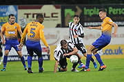 Steven Davies is fouled during the EFL Cup match between Mansfield Town and Rochdale at the One Call Stadium, Mansfield, England on 8 August 2017. Photo by Daniel Youngs.