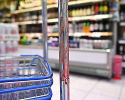 © Licensed to London News Pictures. 27/06/2019. London, UK. Blood covers shopping baskets inside Intercontinental Foods supermarket in Shepherds Bush, the scene of a fatal stabbing last night. The 18 year old victim is understood to have stumbled into the shop seeking refuge after being stabbed outside by two assailants who fled down an alley. Photo credit: Guilhem Baker/LNP