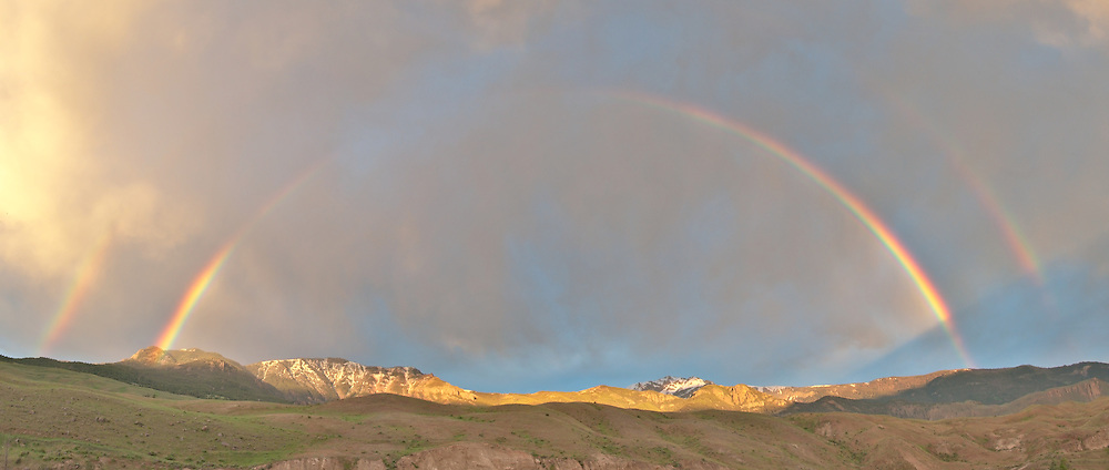 A rainbow in the early morning light, in Gardiner, Montana, just outside of the north entrance of Yellowstone National Park.  Photo by William Byrne Drumm.