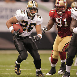 2008 September 28: New Orleans Saints running back Deuce McAllister (26) runs away from San Francisco 49ers defensive end Ray McDonald (91) during the NFL week four game between the San Francisco 49ers and the New Orleans Saints at the Louisiana Superdome in New Orleans, LA.