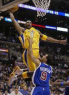The Los Angeles Lakers' Kobe Bryant finishes an alley-oop from Chucky Atkins over the Clippers' Rick Brunson during the Lakers' 103-89 victory over their hometown rivals at Staples Center Wednesday November 17, 2004..