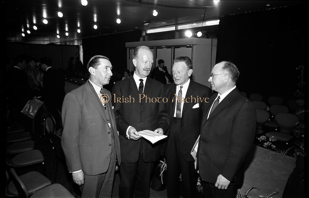 05/04/1965<br /> 04/05/1965<br /> 05 April 1965<br /> Second Irish Export Fashion Fair opened at the Intercontinental Hotel, Dublin. Picture shows (l-r): Mr. Willis Murphy, President of Irish Exporters Association; Mr J.C.B. McCarthy, Secretary, Department of Industry and Commerce; Mr. John Haughey, Chairman Coras Trachtala and Mr. Sydney Gibson, President Federation of Irish Industries chatting at the Fair.