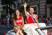 New York, NY - 25 June 2017. New York City Heritage of Pride March filled Fifth Avenue for hours with groups from the LGBT community and it's supporters. Grand Marshall Krishna Stone waves to spectators. Krishna Stone is Assistant Director of Community Relations in the Communications Department at Gay Men's Health Crisis (GMHC).