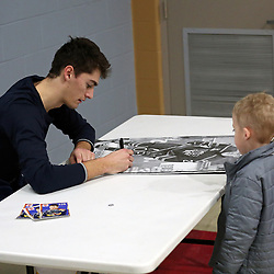 WELLINGTON, ON - JANUARY 25: Joe Roy #28 of the Wellington Dukes meets a young fan after the game on January 25, 2019 at Wellington and District Community Centre in Wellington, Ontario, Canada.<br /> (Photo by Ed McPherson / OJHL Images)