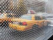 Urban abstract scene of New York City Yellow Taxi reflected in truck, Manhattan, NYC.