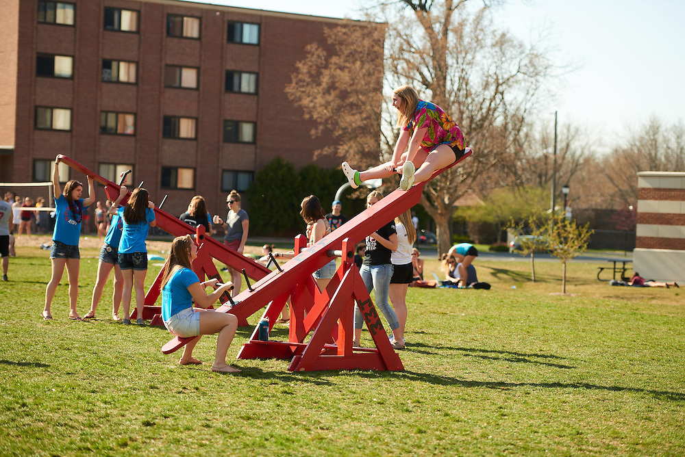 Activity; Socializing; Playing; Buildings; Eagle Hall; Location; Outside; People; Student Students; Spring; April; Time/Weather; sunny; Type of Photography; Candid; UWL UW-L UW-La Crosse University of Wisconsin-La Crosse; Teeter totter