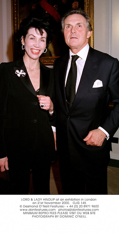 LORD & LADY HINDLIP at an exhibition in London on 21st November 2000.OJG 145