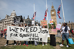 June 21, 2017 - London, UK - 'Day of Rage' protesters in Parliament Square during a demonstration demanding justice for the victims of the Grenfell Tower fire and an end to the current Conservative government. (Credit Image: © Rob Pinney/London News Pictures via ZUMA Wire)