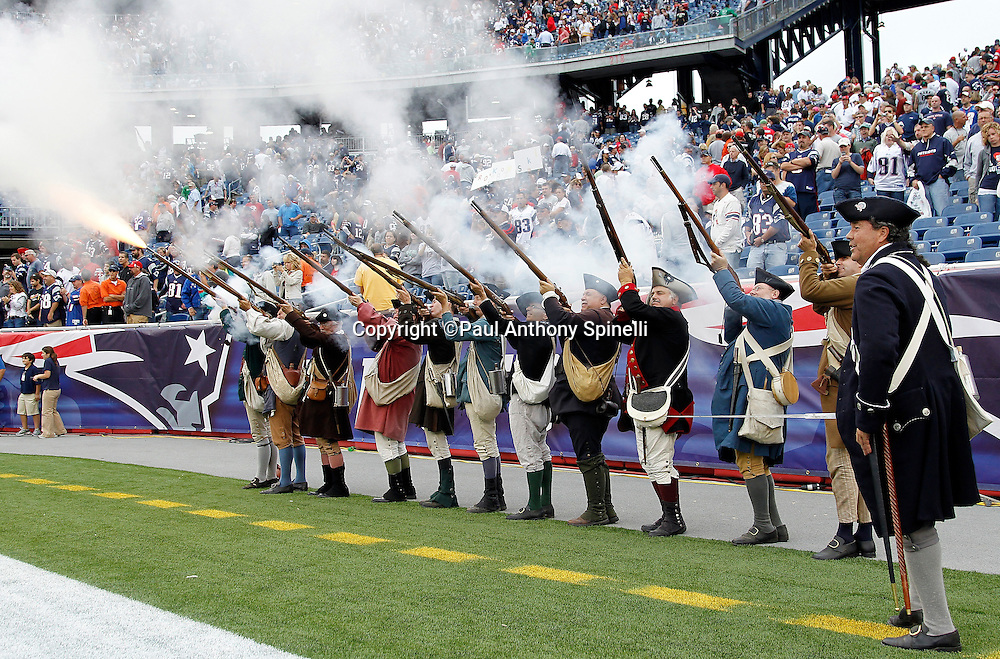 Minutemen fire their muskets after the New England Patriots win the NFL regular season week 3 football game against the Buffalo Bills on September 26, 2010 in Foxborough, Massachusetts. The Patriots won the game 38-30. (©Paul Anthony Spinelli)