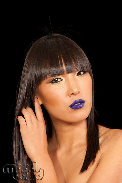 Stylish woman with straight hair and vibrant blue lipstick
