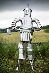 © Licensed to London News Pictures. 26/06/2015. Settle, UK. Picture shows a tin man made from flower pots at Settle flower pot festival. The market town of Settle in the Yorkshire Dales is set to go flower pot mad over the weekend with the second Flower Pot Festival taking place. Locals in the town use the flower pots to make men, snakes, dogs, spiders & even a darlek.  Photo credit : Andrew McCaren/LNP