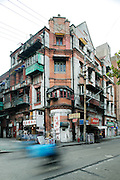 Bicycle zooms past in Old Shanghai, China