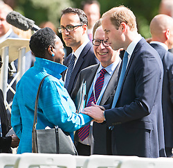 © Licensed to London News Pictures. 07/07/2015. London, UK. PRINCE WILLIAM places a hand on a womanise arm to comfort her at the memorial, following the service. A memorial service in Hyde Park London on the 10th anniversary of the 7/7 bombings in London. The event is attended by Prince William, survivors of the attack and family of those who lost their lives. Photo credit: Ben Cawthra/LNP