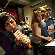 """December 5, 2013 - New York, NY: Members of the NBC musical drama television series """"Smash"""", and their ensemble and band, including, from left, Krysta Rodriguez, Dennis Michael Keefe (bass), Monet Julia Sabel, Eric Michael Krop, and Hiroko Taguchi (violin), rehearse at Smash Studios at 36th Street in Manhattan on Thursday afternoon in preparation for their cabaret performance of """"HIT LIST,"""" which will premiere Sun, Dec 8 at 54 Below. CREDIT: Karsten Moran for The New York Times"""