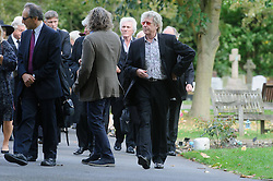 © Licensed to London News Pictures. 07/10/2014London, UK. Friends of Lynsey de Paul arriving for the funeral of singer Lynsey de Paul in Hendon, North London.  Photo credit : Simon Jacobs/LNP