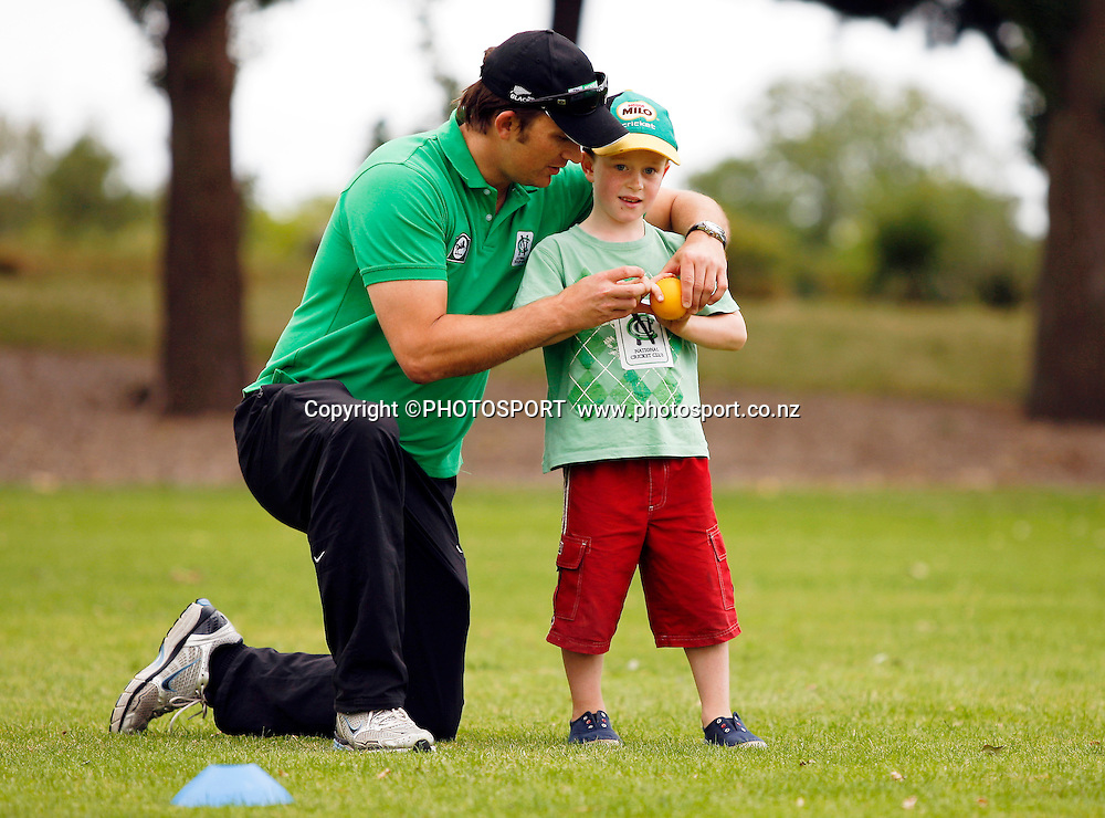 Shane Bond demonstrates to Nicholas Gibb (6) how to hold the ball for bowling during the National Bank Super Camp, a National Bank  initiative to connect with cricket's grass roots. Held at the East Shirley Cricket Club, Christchurch, New Zealand. Thursday 27 January 2011. Joseph Johnson / PHOTOSPORT.