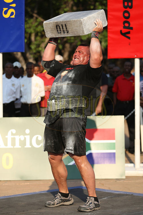 Christian Savoie (Canada) puts in all his strength to lift the 110kg metal block above his head during one of the qualifying rounds of the World's Strongest Man competition held in Sun City, South Africa.