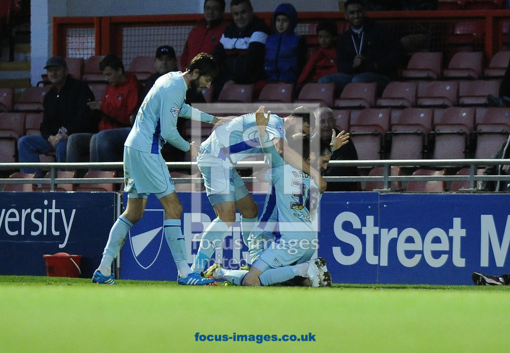 (left to right)Adam Barton of Coventry City, Aaron Martin, goalscorer Jim O'Brien and James Maddison celebrate scoring the equaliser late in the game to get a 2-2 draw during the Sky Bet League 1 match at the Matchroom Stadium, London<br /> Picture by Alan Stanford/Focus Images Ltd +44 7915 056117<br /> 01/11/2014