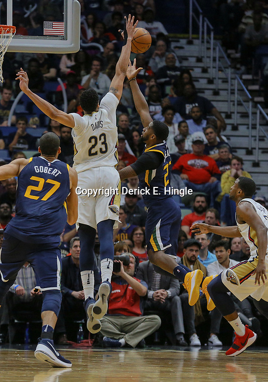Mar 11, 2018; New Orleans, LA, USA; New Orleans Pelicans forward Anthony Davis (23) blocks a shot by Utah Jazz forward Royce O'Neale (23) during the first half at the Smoothie King Center. Mandatory Credit: Derick E. Hingle-USA TODAY Sports