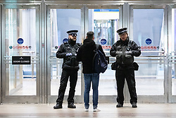 © Licensed to London News Pictures. 08/01/2019. London, UK. Security guards divert members of the public at the scene where a man has died after falling from height in Canary Wharf Shopping Centre. He was pronounced dead at the scene shortly after 9am. Yesterday, another man died at Canary Wharf station after also falling from height. Photo credit : Tom Nicholson/LNP