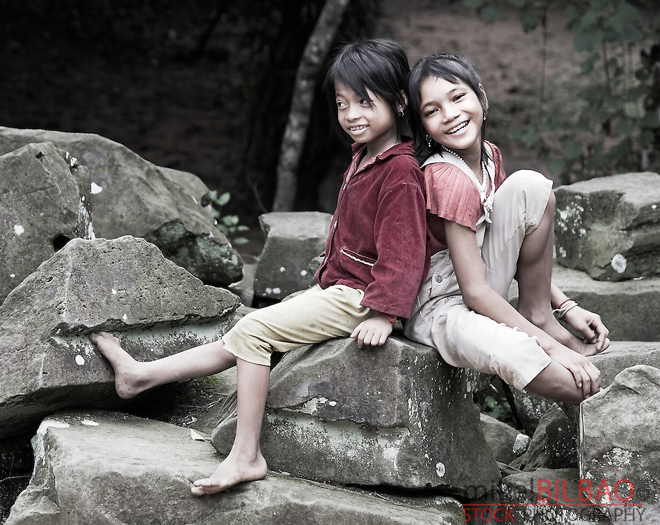young girls portrait in Cambodia in Angkor ruins.