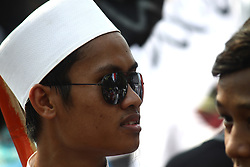 July 28, 2017 - Central Jakarta, Capital Region Of Jakarta, Indonesia - Muslims from various organization held a peace action in front of National Monument, Jakarta, on July 28, 2017. The action was conducted as support and escort to some of their candidates who filed a judicial review to the Constitutional Court on Government Regulation in Lieu of Law on Community Organizations which some articles in it they consider to violate Human Rights and the Right to Organize. (Credit Image: © Tubagus Aditya Irawan/Pacific Press via ZUMA Wire)