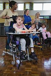 Group of children with physical disabilities exercising,