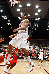 Nov 14, 2011; Stanford CA, USA;  Stanford Cardinal forward Josh Huestis (24) celebrates after a dunk against the Fresno State Bulldogs during the first half of a preseason NIT game at Maples Pavilion. Mandatory Credit: Jason O. Watson-US PRESSWIRE