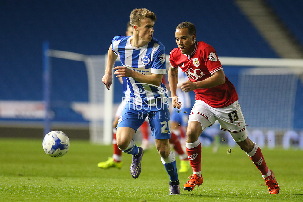 Brighton striker, Solomon March (20) on the ball and battles with Bristol City midfielder Elliott Bennett (13) during the Sky Bet Championship match between Brighton and Hove Albion and Bristol City at the American Express Community Stadium, Brighton and Hove, England on 20 October 2015. Photo by Phil Duncan.