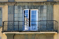 French doors open onto a wrought iron balcony overlooking the Zocalo, Oaxaca, Mexico.