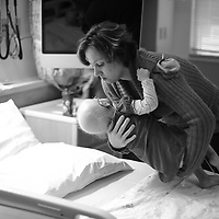 Jill Jacobs places Kiersa back onto the hospital bed during an overnight stay at the hospital. ..