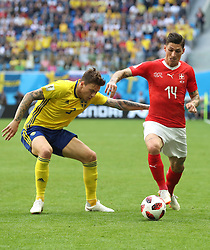 SAINT PETERSBURG, July 3, 2018  Steven Zuber (R) of Switzerland vies with Victor Lindelof of Sweden during the 2018 FIFA World Cup round of 16 match between Switzerland and Sweden in Saint Petersburg, Russia, July 3, 2018. (Credit Image: © Cao Can/Xinhua via ZUMA Wire)