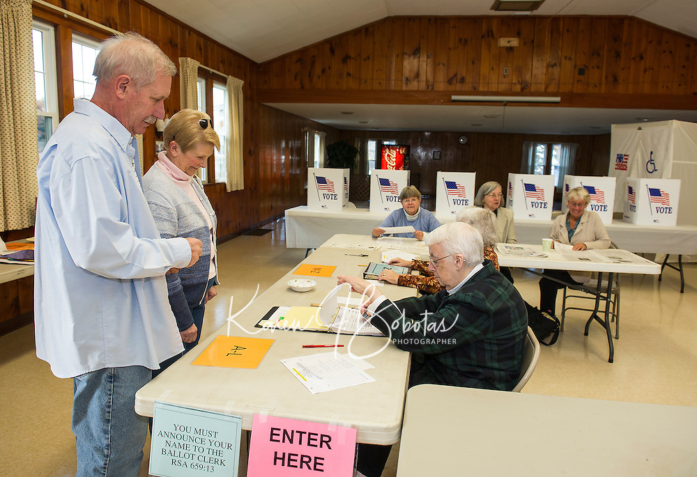 Nancy Merrill, Ramona Fournier, Brenda Moulton, Marena Schultz and Faye Nachbaur check in Ward 6 voters at Leavitt Park Clubhouse on election day Tuesday morning.  (Karen Bobotas/for the Laconia Daily Sun)