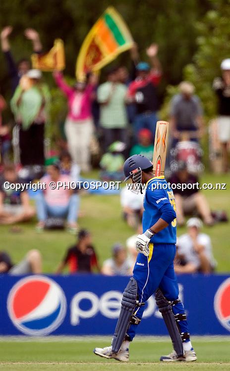 Sri Lankan player Danishka Gunathilleke raises his bat to the Sri Lankan supporters after reaching 50. New Zealand v Sri Lanka, U19 Cricket World Cup group stage match, Village Green, QEII, Christchurch, Wednesday 20 January 2010. Photo : Joseph Johnson/PHOTOSPORT