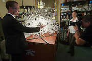 Johannes Rath of Lobmeyr at a reception to celebrate the restauration of 11 crystal chandeliers Lobmeyr had created for the foyer and auditorium of New York's Metropolitan Opera, in 1966..The Sputnik-like steel structures with 51.000 individual crystals are completely dismantled, cleaned, and re-built from the ground, while many missing crystals and damaged or outdated parts are being replaced. This takes approximatley one month..Lobmeyr's prestigeuos client list includes H.R.H. Queen Elisabeth II., the Sultan of Brunei, Arnold Schwarzenegger and many others.