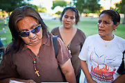 July 6 - PHOENIX, AZ: Women pray during a vigil at the Arizona State Capitol in Phoenix Tuesday. Immigrant rights' activists have been holding a prayer vigil in opposition to Arizona's tough new anti-illegal immigrant law, SB 1070, which is supposed to take effect on July 29. The bill requires local police and law enforcement agencies to verify the immigration status of people they suspect might be in the US illegally. Opponents of the bill fear it will lead to racial profiling. The US Justice Department announced Tuesday afternoon that they would file suit against Arizona to prevent implementation of SB 1070. They are filing suit on the grounds that immigration enforcement is the exclusive domain of the federal government.       Photo by Jack Kurtz